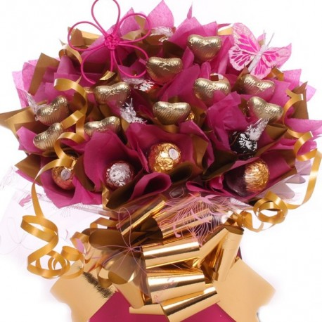 Luxury Ferrero Rocher and Lindor Chocolate Bouquet with milk chocolate hearts.