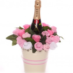 Champagne baby clothing flower pot.